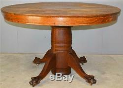 17812 Round Tiger Sawn Oak Claw Foot dining Table 2 Leaves