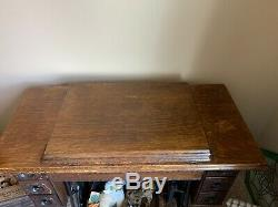 1908 Singer Sewing Treadle Sewing Machine in Tiger Oak Cabinet, 7 drawers