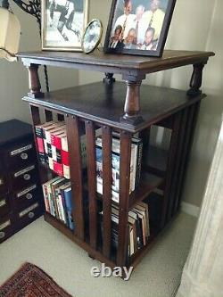 #2 of 3 ANTIQUE REVOLVING BOOKCASES with2 FLAT SHELVES, TIGER OAK, NUMBERS, CASTERS