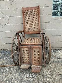 Antique Arrow Wheel Chair Tiger oak and wicker ww1 rare find 1800s (not Sure)
