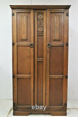 Antique English Tiger Oak Carved Double Door Wardrobe With Linen Fold Accents
