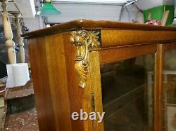 Antique Oak display cabinet Tiger Oak Carved lions in the corners