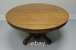 Antique Round Quartersawn Tiger Oak Dining Table with Paw Feet