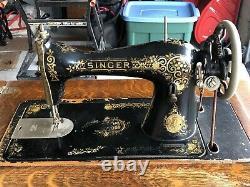 Antique Singer Treadle Sewing Machine In A Tiger Oak Closed Cabinet
