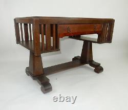 Antique Stickley era tiger oak mission desk with side Book shelves. 44 inches
