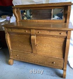 Antique tiger oak Empire sideboard buffet with beveled glass mirror