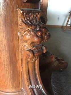 Early Tiger Oak Carved Claw Feet Dining Table with Leaves lion dragon head claw