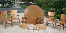 Gorgeous Tiger Oak round table with leaves. Four vintage chairs. Local pickup