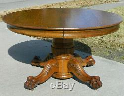 Solid Tiger Oak Dining Table 54 Inches RoundExtends to 77 inches with3 leaves