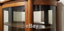 Tiger Oak Antique Curio Cabinet With Curved Glass And Claw Feet