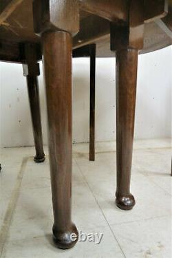 Vintage English Tiger Oak Drop Leaf Gate Leg Oval Dining Table