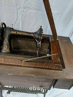 Vintage National TWO SPOOL Treadle Sewing Machine Tiger Oak cabinet